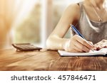 woman hand and blue pen  | Shutterstock . vector #457846471