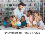 pupils and teacher looking at... | Shutterstock . vector #457847221