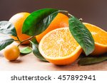 Oranges With Shoots On A Woode...