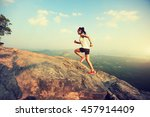 young asian woman runner... | Shutterstock . vector #457914409
