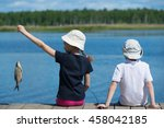 Children On The Dock With Fish