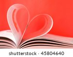 open book with bent pages in the form of heart - stock photo