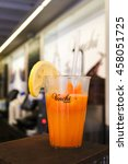 Small photo of VERONA, ITALY - JULY 19, 2016 : Photo of a glass of orange juice by Venchi Gelato. Venchi Gelato is Italian gourmet chocolatier manufacturer, since 1878. Now it has 75 shops operated worldwide.