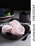Small photo of Homemade light and airy marshmallow dessert with berries