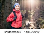 woman hiking with akita inu dog ... | Shutterstock . vector #458109049