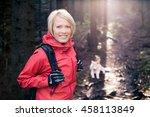 woman hiking with akita inu dog ... | Shutterstock . vector #458113849