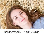 happy woman on hay stack in... | Shutterstock . vector #458120335