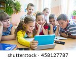 Small photo of Children of primary school are enrolled in the class of tablet