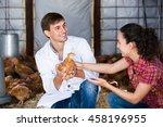 Man Veterinarian Holding...