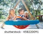 Kids In Big Swing At The...