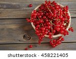Red Currant On Brown Wooden...
