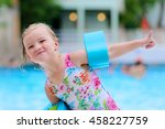Little Child Enjoying Swimming...