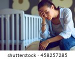 young tired woman sitting on... | Shutterstock . vector #458257285