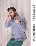 Small photo of Man have grown whiskers symbol. funny guy hipster bewhiskered. Gay men on the floor, heavy beard. Funny emotions on the man's face, symbol