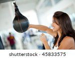 Boxing woman at the gym hitting a punching ball - stock photo