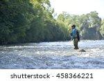 flyfisherman fishing in... | Shutterstock . vector #458366221