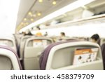 Small photo of blur image of inside the airplane with people. Sky Low Trip Room Power View Rear Indoor Aisle Board Focus Line Sit Fly Wear Flying Formal Sign Air Crew Scene Blur Men Class Jet Row Seat White Chair