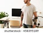 brutal tattoooed man in blank t ... | Shutterstock . vector #458395189