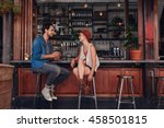 shot of young couple sitting at ... | Shutterstock . vector #458501815