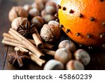 Orange With Cloves And Nuts On...