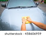 hand polishing the car hood ... | Shutterstock . vector #458606959
