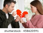 young couple holding ripped... | Shutterstock . vector #458620591