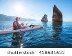 a man fishing on a kayak boat... | Shutterstock . vector #458631655