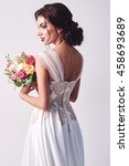 Woman In Wedding Dress With...