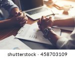 Small photo of Hand, two men on a desk. Negotiating business.