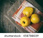 Three Ripe Yellow Quince On A...