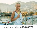 Young Blond Tourist Woman With...