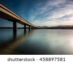 long bridge over a lake with...