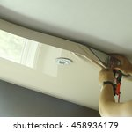 master repairs stretch ceiling... | Shutterstock . vector #458936179