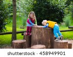 little boy and girl climbing on ... | Shutterstock . vector #458949901