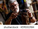 senior sculptor working on his... | Shutterstock . vector #459031984
