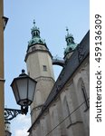 Small photo of Old street light and Tower of Marktkirche Halle (Saale) Germany