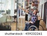 Businessman Assisting Handicap...