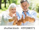 senior couple showing thumbs up  | Shutterstock . vector #459288571