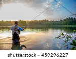young man flyfishing at sunrise | Shutterstock . vector #459296227