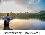 young man flyfishing at sunrise