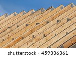 row of timber roof trusses in a ...
