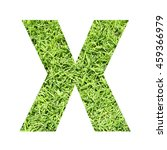 Small photo of The outline of English capital letter 'X' isolated on white background and filled in with actual photo of green grass lawn with applicable clipping or working path for design project
