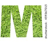 Small photo of The outline of English capital letter 'M' isolated on white background and filled in with actual photo of green grass lawn with applicable clipping or working path for design project