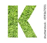 Small photo of The outline of English capital letter 'K' isolated on white background and filled in with actual photo of green grass lawn with applicable clipping or working path for design project