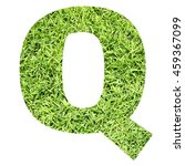 Small photo of The outline of English capital letter 'Q' isolated on white background and filled in with actual photo of green grass lawn with applicable clipping or working path for design project