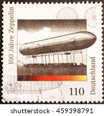 Small photo of Milan, Italy - July 19, 2016: Centenary of Zeppelin airship on german postage stamp