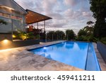modern house with a pool at... | Shutterstock . vector #459411211