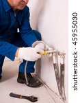 Plumber fixing water pipe - stock photo