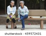 Two Older Asian Women Sitting...