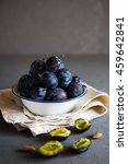 Plums In A Bowl On A Rural...